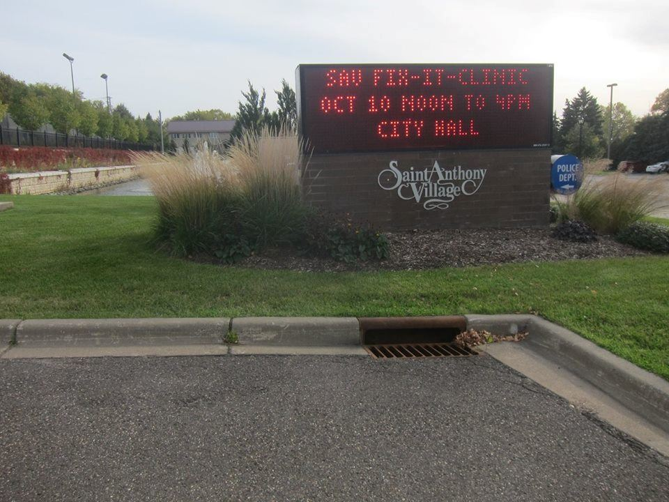 A sign advertising a Fix-It Clinic at St. Anthony Village City Hall.